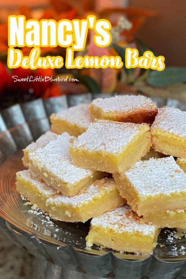 Nancy;s Deluxe Lemon Bars stacked on a plate.
